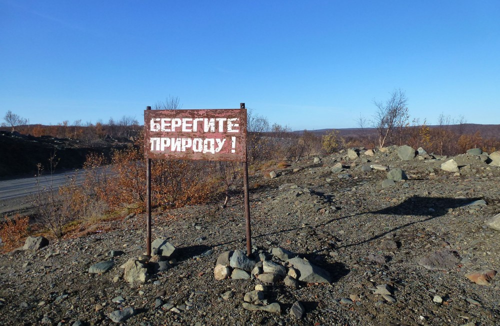 """""""Protect the nature,"""" reads this sign placed near a nickel smelter in the Kola Peninsula. (Atle Staalesen / The Independent Barents Observer)"""
