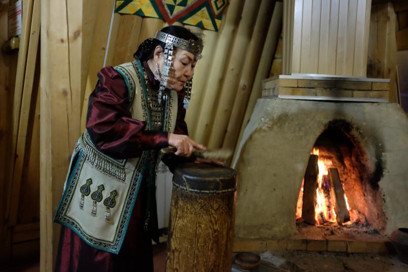 Yakut woman (Yakutka) demonstrating a traditional ceremony at a national restaurant outside Yakutsk.