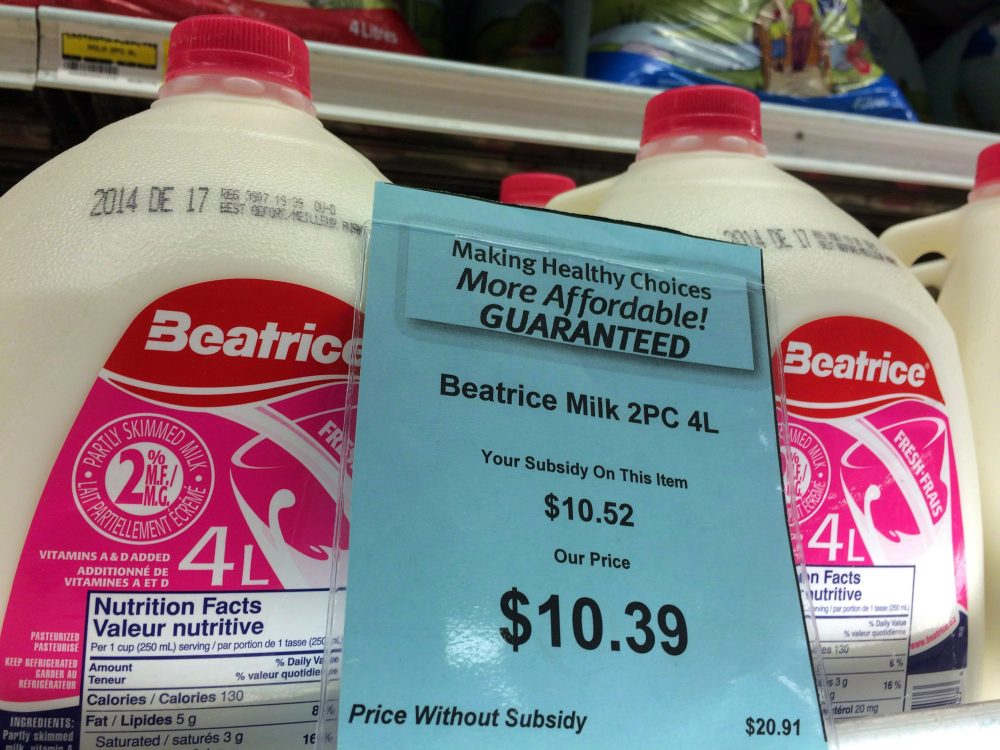A price tag lists the price and subsidy of a 4-litre jug of milk at a grocery store in Iqaluit, Nunavut on December 8, 2014. (Sean Kilpatrick/THE CANADIAN PRESS)