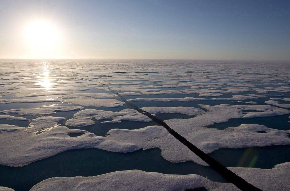 The midnight sun shines over the ice covered waters near Resolute Bay as seen from the Canadian Coast Guard icebreaker Louis S. St-Laurent, Saturday, July 12, 2008. (Jonathan Hayward/THE CANADIAN PRESS)