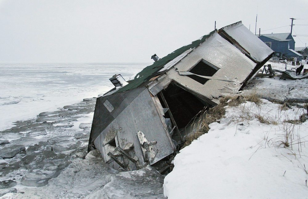 Nathan Weyiouanna's abandoned house at the west end of Shishmaref, Alaska, Dec. 8, 2006, sits on the beach after sliding off during a fall storm in 2005. Like some other Alaska villages, the Inupiat community of 600 is facing an expensive relocation because of erosion, which is eating away at the current site on a narrow island just north of the Bering Strait. (Diana Haecker/AP Photo)