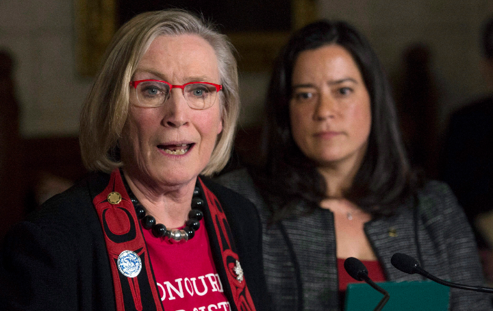 Canada's Minister of Justice and Attorney General of Canada Jody Wilson-Raybould looks on as Minister of Indigenous and Northern Affairs Carolyn Bennett responds to a question in December 2015 during an announcement about the Missing and Murdered Indigenous Women inquiry. (Adrian Wyld/The Canadian Press)