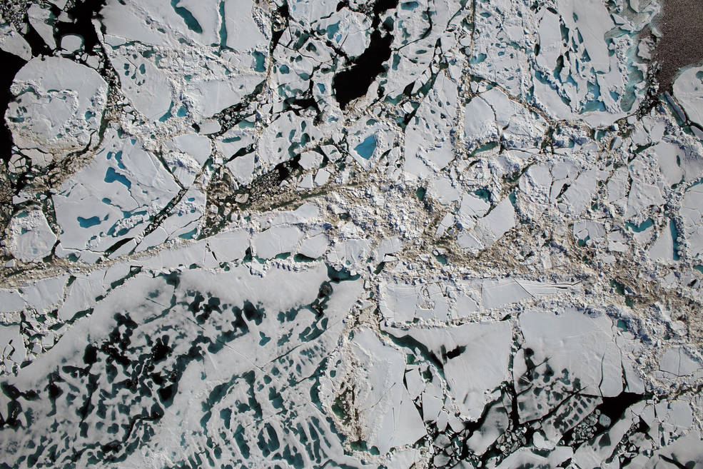 Chunks of sea ice, melt ponds and open water are all seen in this image captured at an altitude of 1,500 feet by the NASA's Digital Mapping System instrument during an Operation IceBridge flight over the Chukchi Sea on Saturday, July 16, 2016. (NASA/Goddard/Operation IceBridge)