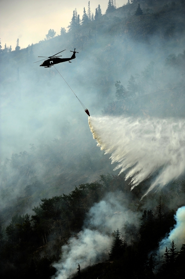 Helicopters dropping water work the McHugh Creek wildfire along the Seward Highway on Wednesday. (Bob Hallinen / Alaska Dispatch News)