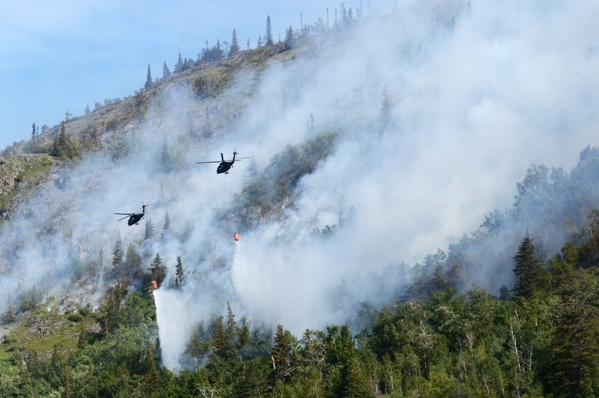 Alaska National Guard helicopters drop water on the McHugh Creek wildfire as it continues to burn near Beluga Point on Wednesday, July 20, 2016, along Turnagain Arm. (Erik Hill / Alaska Dispatch News)