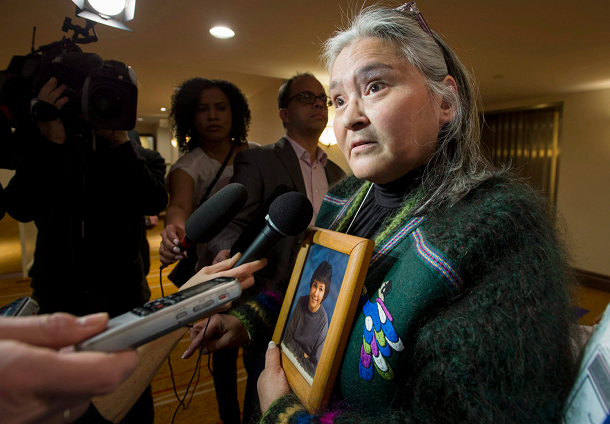 Elisapee Sheutiapik, former mayor of the Arctic Canadian city of Iqaluit holds a photo of Mary Ann Birmingham, who was 15 when she was murdered in Iqaluit in 1986. Sheutiapik was at the National Roundtable on Missing and Murdered Indigenous Women and Girls in Ottawa on Friday, Feb. 27, 2015. (Justin Tang/The Canadian Press)