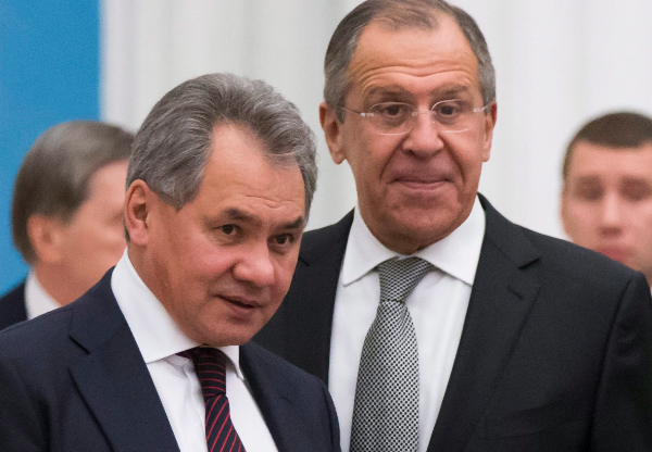 Russian Defense Minister Sergei Shoigu (pictured above left with Russia's Foreign Minister Sergey Lavrov) and his Ministry of Defence are getting a bigger role in Arctic logistic issues. (Alexander Zemlianichenko/AP/The Canadian Press)