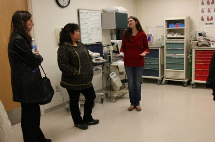 Mary Smith, principal deputy director of the U.S. Indian Health Service, and Gail Alstrom-Beans, longtime operations manager of the St. Marys health clinic, listen on Thursday, Aug. 11, 2016, to Jennifer Spillar, operations manager of the Hooper Bay health clinic. Managers with the Yukon-Kuskokwim Health Corp. led a tour of facilities in Hooper Bay and Chevak to show federal officials the challenges of Bush health care. (Lisa Demer / Alaska Dispatch News)