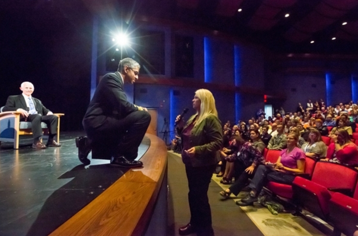 U.S. Surgeon General Vivek Murthy listens to a comment from Kim Whitaker, the mother of a heroin addict, during the Wellness Summit at the Glenn Massay Theater on Thursday. The summit was convened by Sen. Dan Sullivan to address the opioid epidemic. (Loren Holmes / Alaska Dispatch News)