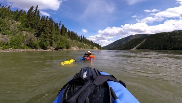 Denis Morin swam, with a riverboard, from Whitehorse, Yukon, to Emmonak, Alaska, between May 25 and Aug. 9 2016. This image is made from a GoPro mounted to his cargo. As Morin swam the upper reaches of the Yukon River, he towed his camp, food and other supplies. (Denis Morin)