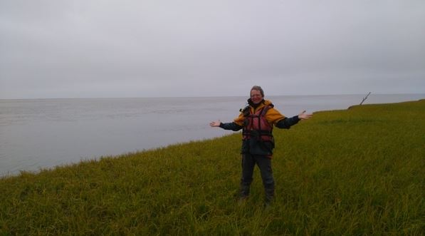 Denis Morin stands on the coast near Emmonak, at the Bering Sea. (Denis Morin)