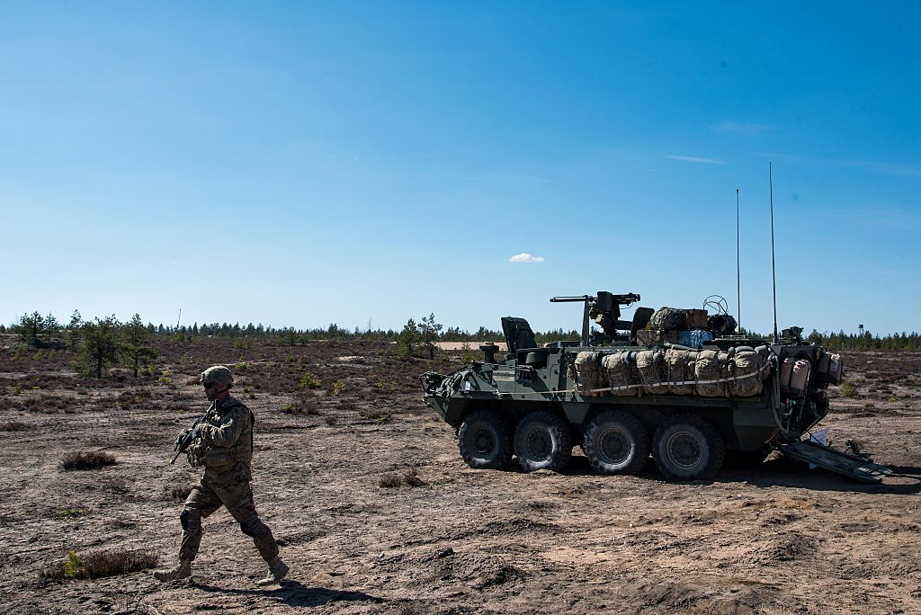 """U.S. army soldier and Stryker armored vehicle during """"Arrow 16"""" mechanised exercise of the Finnish Army in collaboration with U.S. Army Europe's 2nd Cavalry Regiment's Mechanized Infantry Company in Niinisalo, Finland, on May 4, 2016. (ELIAS LAHTINEN/AFP/Getty Images)"""