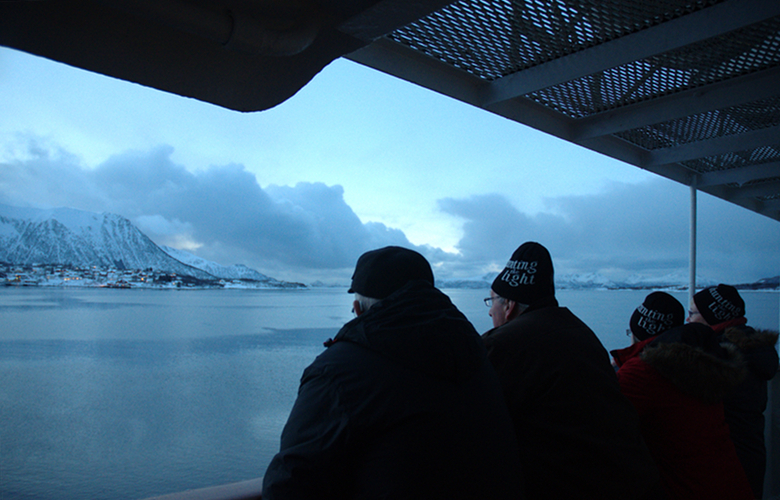 Beanie-wearing German tourists on board a Hurtigruten vessel off northern Norway. (Mia Bennett)