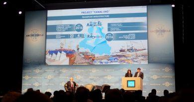 Yamalo-Nenets Autonomous Okrug Governor Dmitry Kobylkin addresses the Arctic Circle assembly through a translator as Anton Vasiliev, Russian Ambassador to Iceland, sits on stage. (Mia Bennett)