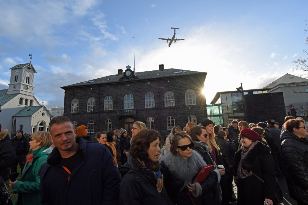 One in five Icelanders say they will vote for the Pirate Party. Here, people in front of the Parliament building in Reykjavik on Monday. (Thomas Nilsen/The Independent Barents Observer)