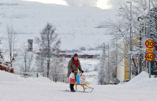 A woman rides her kick sled on a snow covered road in Kiruna, Sweden in 2013. (Jonathan Nackstrand/AFP/Getty Images)