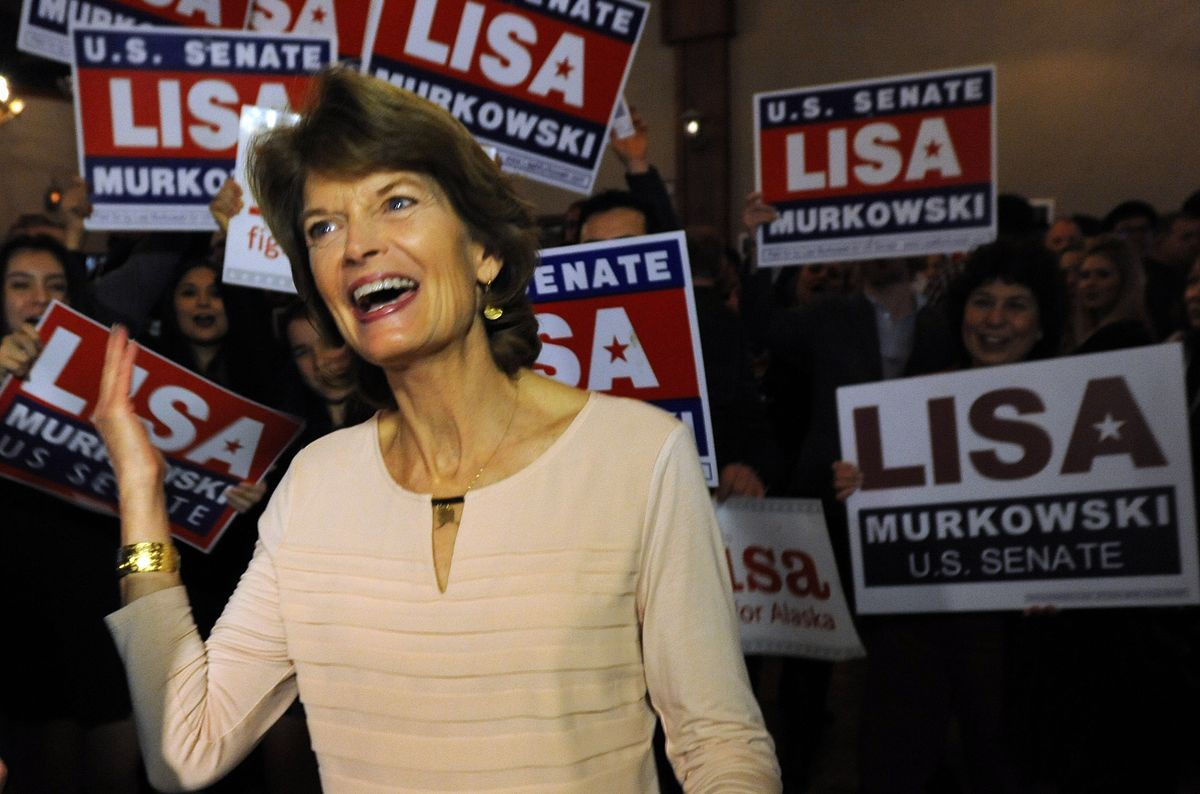 Sen. Lisa Murkowski celebrates with supporters at the 49th State Brewing Co. in Anchorage on election night. (Bill Roth / Alaska Dispatch News)