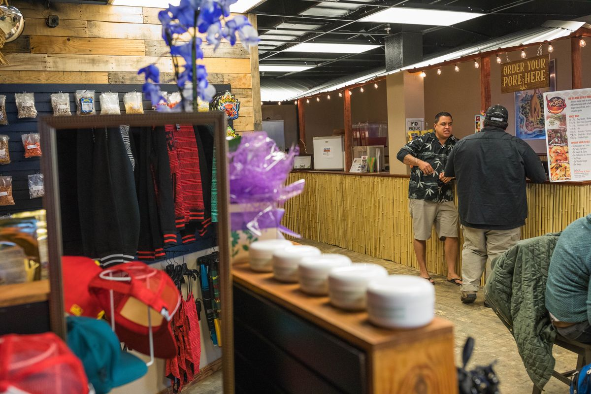 Kahou Akao, left, and Shaun Kahele at the Aloha Stop and Shop on Oct. 28. (Loren Holmes / Alaska Dispatch News)