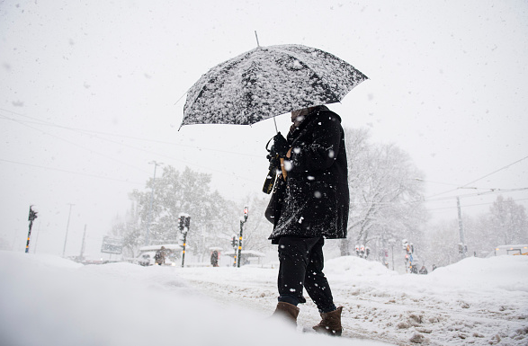 A woman walks during a snow fall on November 9, 2016 in Stockholm. (Jonathan Nackstrand/AFP/Getty Images)