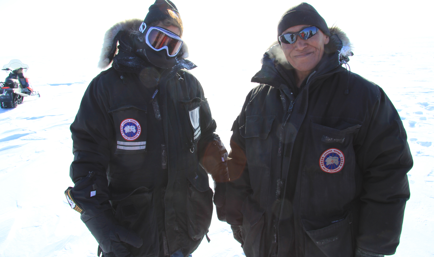 University of Calgary professor Susan Kutz (left) and Cambridge Bay hunter Colin Amegainek out on the land in Cambridge Bay, Nunavut. (Eilís Quinn/Eye on the Arctic)