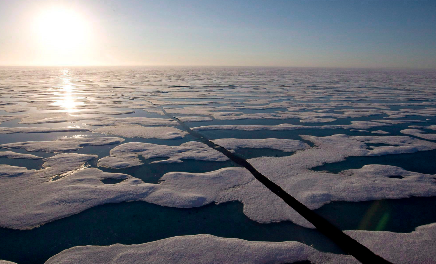 The midnight sun shines over the ice covered waters near Resolute Bay Canada in 2008. (Jonathan Hayward/The Canadian Press)