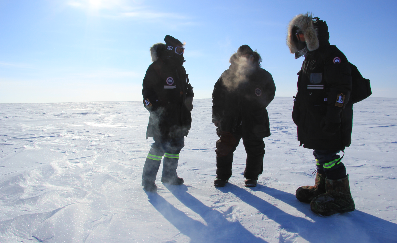 Out on the land in Canada's High Arctic. From left to right: University of Calgary professor Susan Kutz, Cambridge Bay hunter Colin Amegainek, University of Calgary PhD student Juliette Di Francesco. Partnerships between indigenous knowledge and science are increasingly important to understanding Arctic climate change. (Eilís Quinn/Eye on the Arctic)