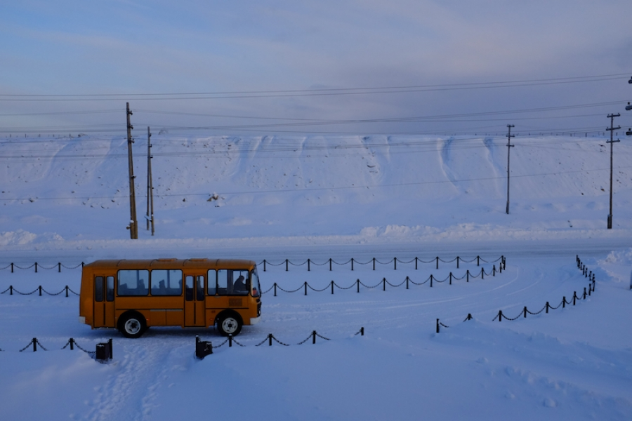 Our little bus waiting for us to finish looking at the open-pit mine in Mirny City, Russia. (Mia Bennett)