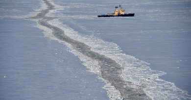 Ships carry ore from Canadian Arctic through Northern Sea Route