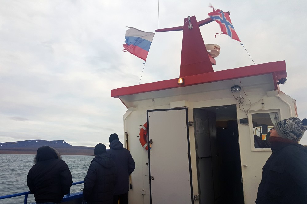 "GoArctic's boat ""Barentsburg"" has both Norwegian and Russian flag in the mast. (Thomas Nilsen/The Independent Barents Observer)"