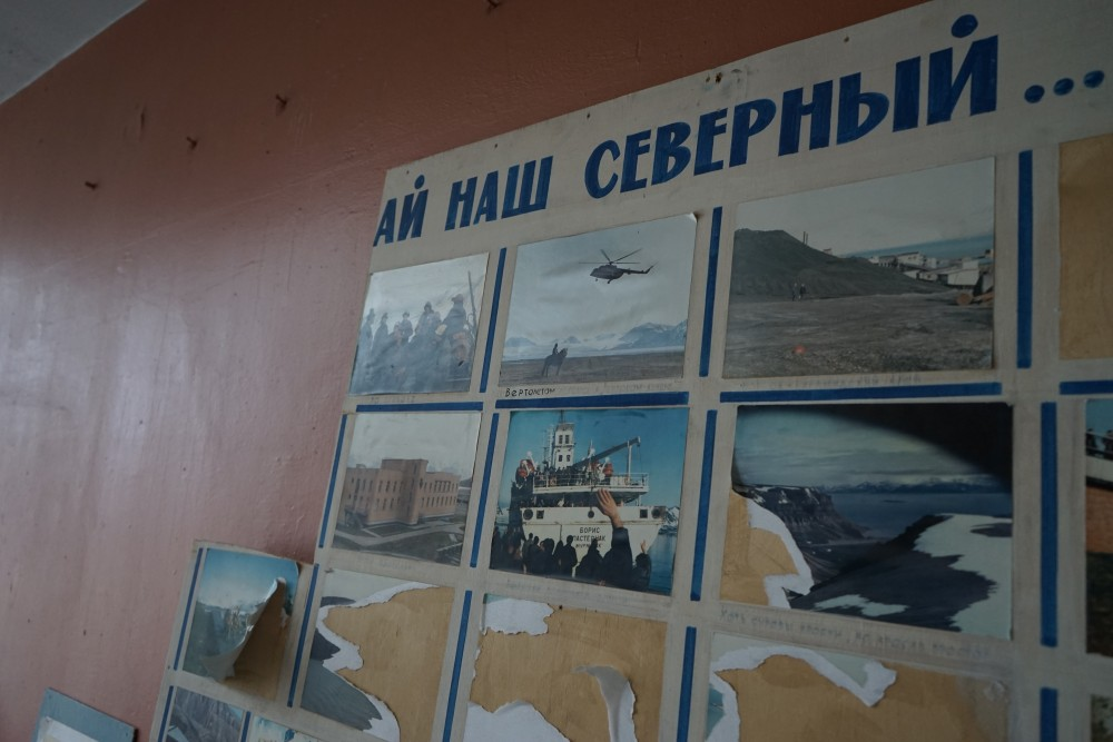"""…. our northern,"" reads half of the photo-collection poster left on the wall in the palace of culture. (Thomas Nilsen/The Independent Barents Observer)"