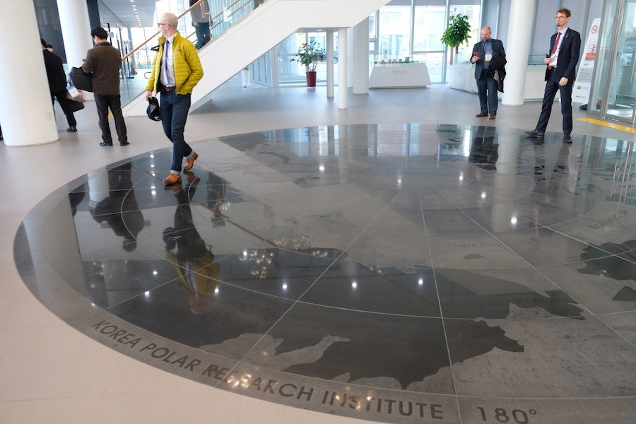 KOPRI's grand lobby with maps of the Arctic and Antarctic laid out in floor mosaics. (Mia Bennett/Cryopolitics)