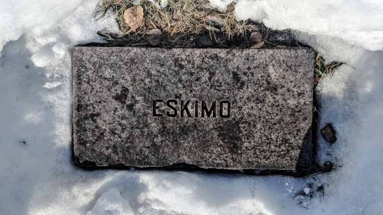 569b56489b0 Who is the person named 'Eskimo' buried in a cemetery in Northern Canada?