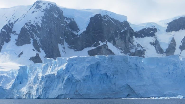 Tall ice cliffs are slumping and may trigger rapid sea-level