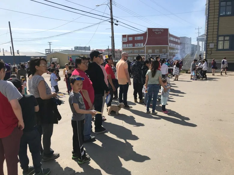 People mill around Iqaluit's Four Corners in the city's downtown core. (Sara Frizzell/CBC)