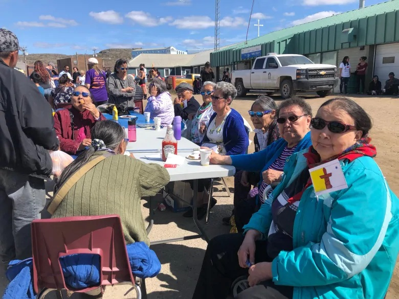 People soak up the sunshine in Iqaluit as Nunavut celebrates 26 years since the Nunavut Land Claims Agreement Act went into effect. (Madeleine Allakariallak/CBC)