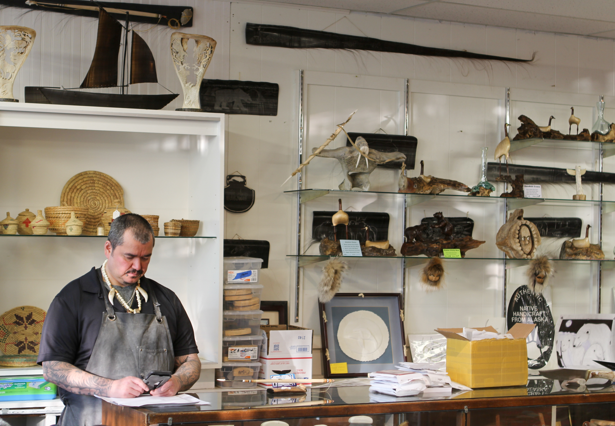 How one man has made a place for struggling ivory carvers in Anchorage, Alaska