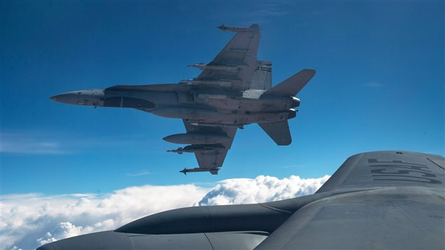 Un CF-18 du Canada dans le ciel irakien. Photo crédit : Staff Sgt. Perry Aston