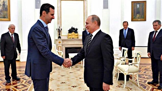 Le président Bachar al-Assad lors d'une rencontre avec le président russe, Vladimir Poutine en décembre dernier.