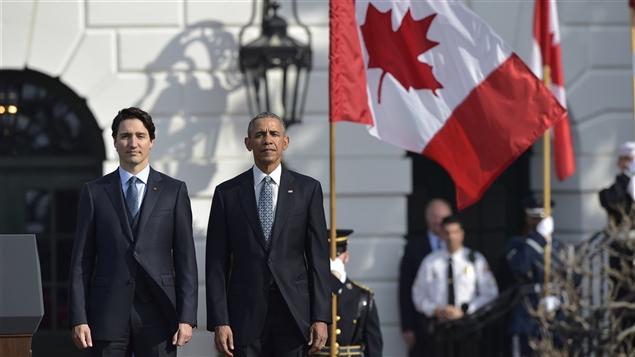 Le premier ministre Trudeau aux côtés du président Obama à la Maison-Blanche. © Getty/AFP/MANDEL NGAN