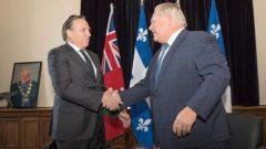 Les premiers ministres François Legault (à gauche) et Doug Ford lors d'une rencontre à Toronto en novembre 2018 - La Presse Canadienne / Chris Young