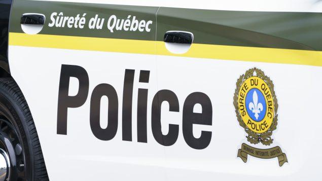 À Sherbrooke, les policiers ont épinglé 82 contrevenants. Les agents du Service de police de Sherbrooke ont intercepté 689 conducteurs et 247 pour vérifier s'ils avaient un motif valable pour braver le couvre-feu - Photo : Archives / Paul Chiasson / La Presse Canadienne
