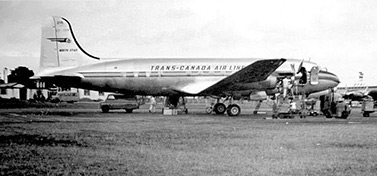 A DC-4 aircraft in the 1950's. The plane sports the colors of Trans-Canada Airlines, Air Canada precursor. (Museum of Aviation and Space in Canada)