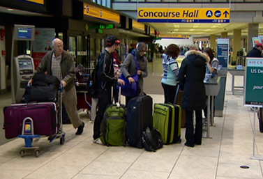 It`s a busy day for several passengers at the Calgary International Airport, Alberta.   (Canadian Broadcasting Corporation)