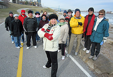 Canadians' favourite form of physical activity is walking, even in winter. Here, a group of residents from Windsor, Ontario, have organized an official walking day. The U.S. city of Detroit can be seen in the background, to the right. (CBC News)