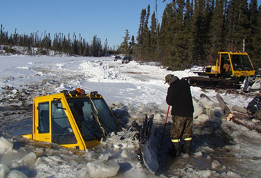 This tractor specializes in snow removal from ice roads. It lost control in northern Ontario in January 2013. The two men on board came very close to losing their lives. (Kitchenuhmaykoosib Inninuwug)