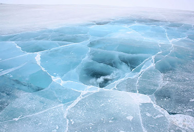 A section of ice road in northern Canada. The colors of ice give important clues to its strength. (Ian Mackenzie)