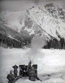 The military trigger an avalanche along the Trans-Canada Highway in the 1960s. (Parks Canada)