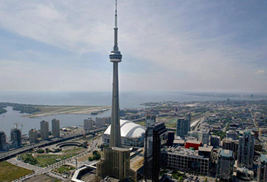 CN Tower was opened to the public on June 26, 1976. Each year, 2 million tourists ride the glassed-in elevators 342m up to the SkyPod with its wide observation decks and the world's highest revolving  restaurant. (Kevin Frayer/Canadian Press)
