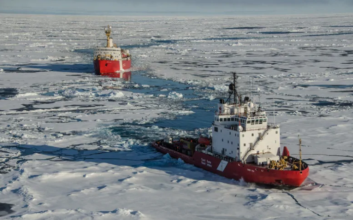 CCGS Terry Fox breaks the ice in front of CGGS Louis S. St-Laurent during a scientific mission mapping Canada's Arctic continental shelf in 2015 (Gary Morgan/Canadian Coast Guard).