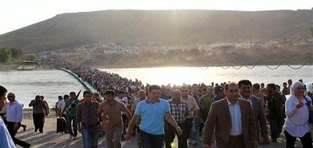 Des réfugiés syriens traversent le Tigre pour atteindre le Kurdistan irakien Photo : Reuters